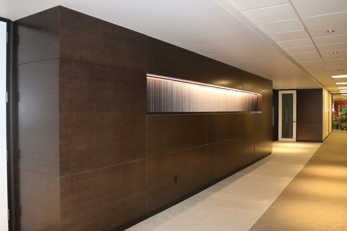 Hallway with wood paneling and art niche