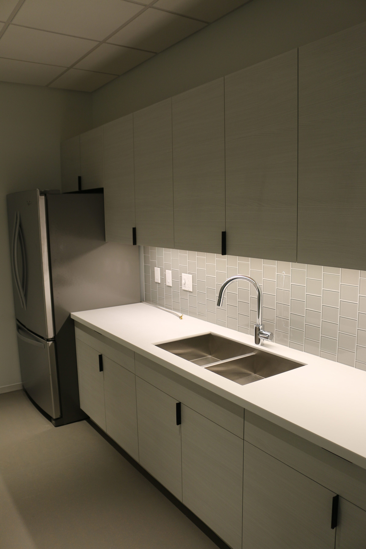 Kitchen with cupboards, countertop, tiles