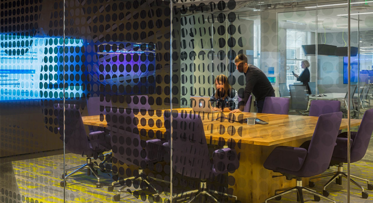 AOL Conference room with printed glass, table, and media