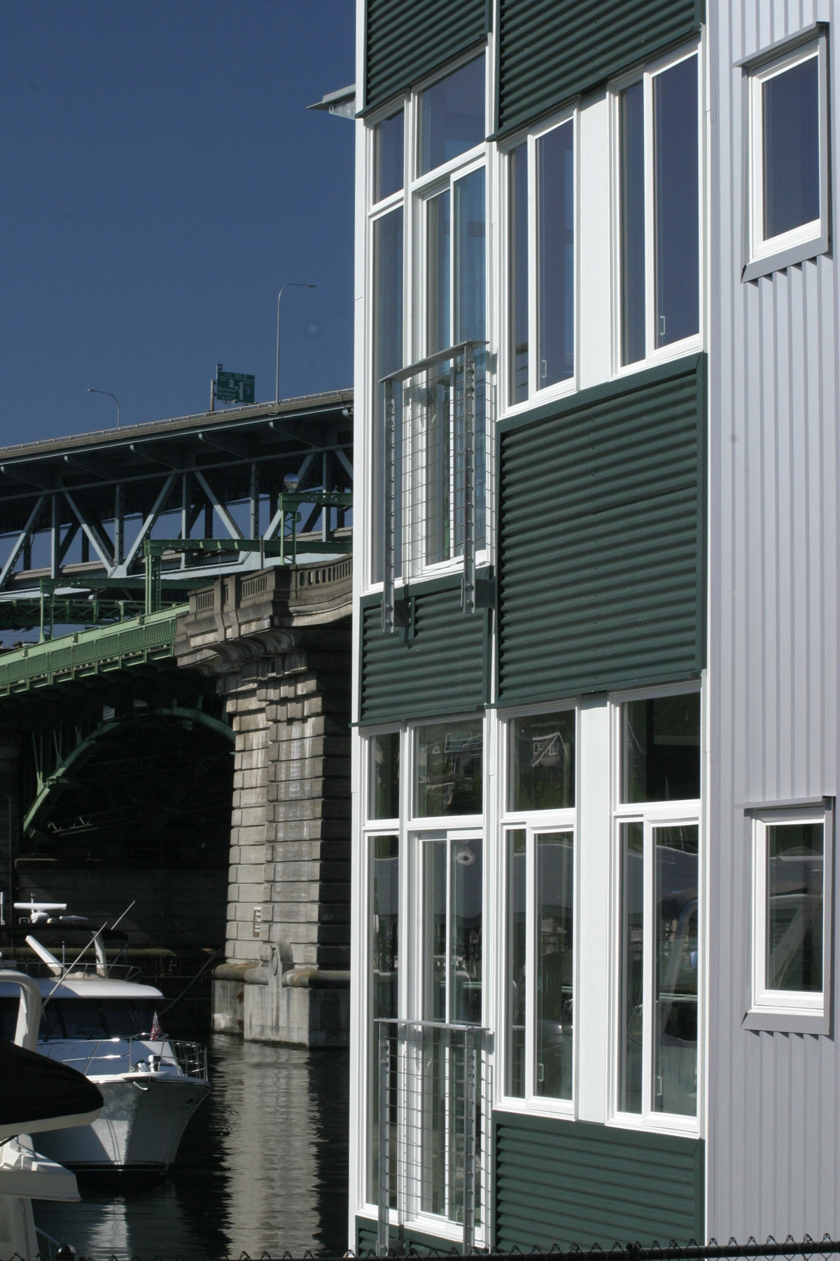 Boat Street Landing building waterfront bridge and boats