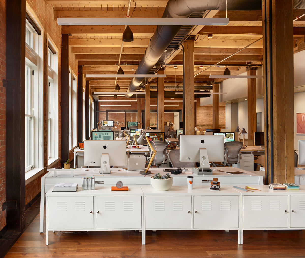 Fifty Three office desks, exposed beams and nautral wood