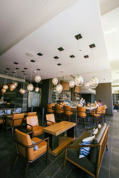 Interior view of restaurant with acoustical ceiling and custom lighting