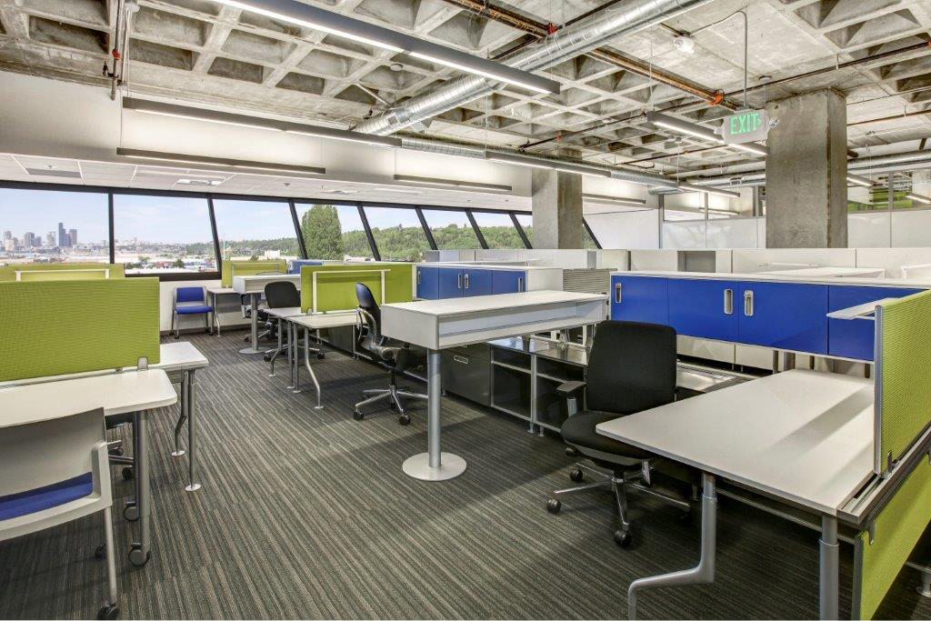 Open Square office interior colorful desks and windows