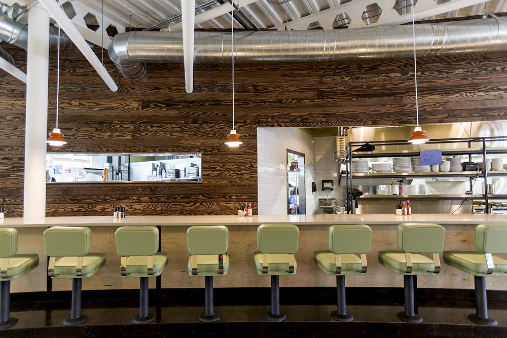 Skillet Diner bar seating, natural wood panels