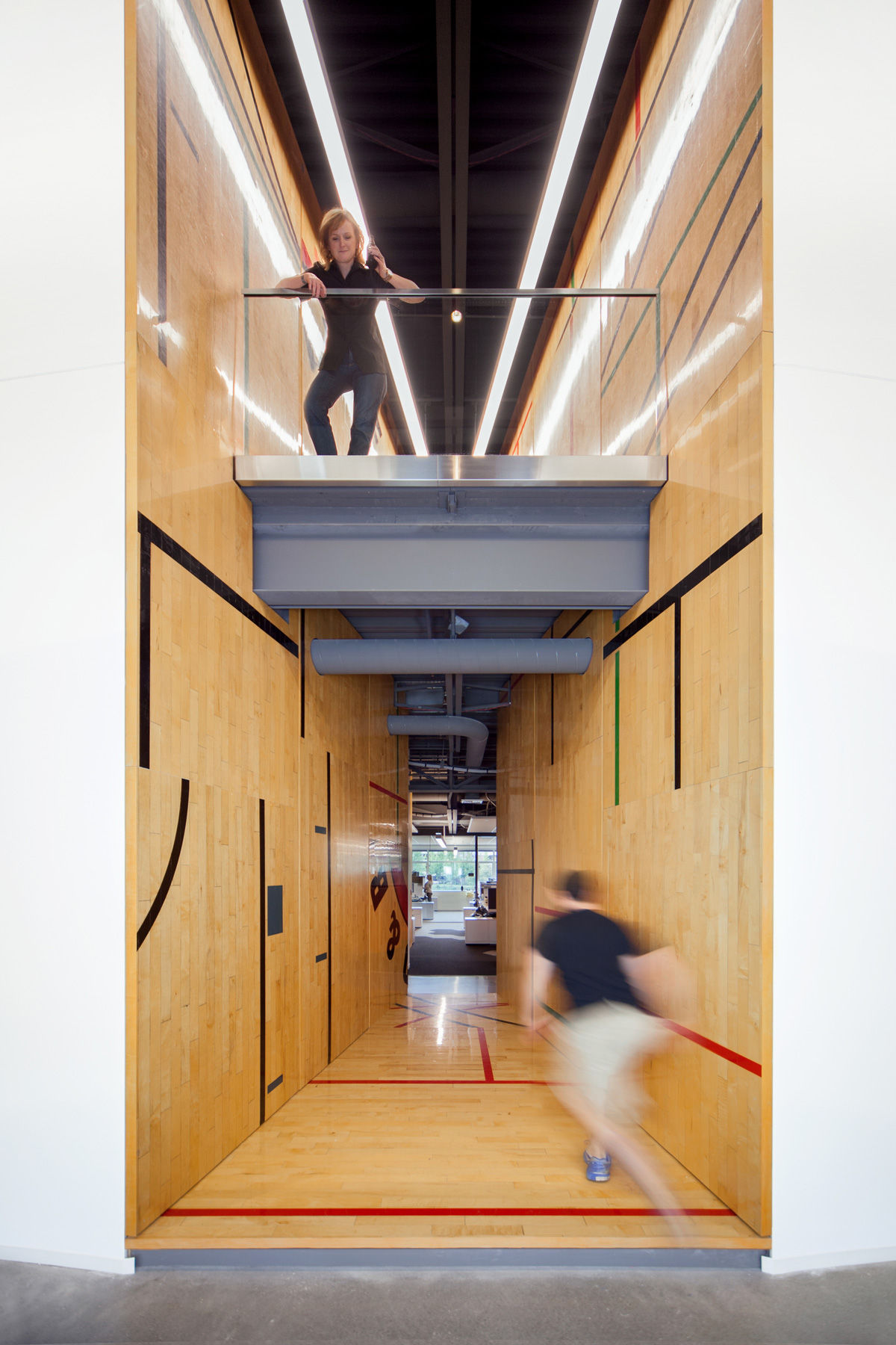 Tableau office hallway with reclaimed wood flooring and walls